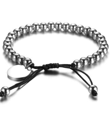 Flot perlearmbånd i stål med læder låsemekanisme